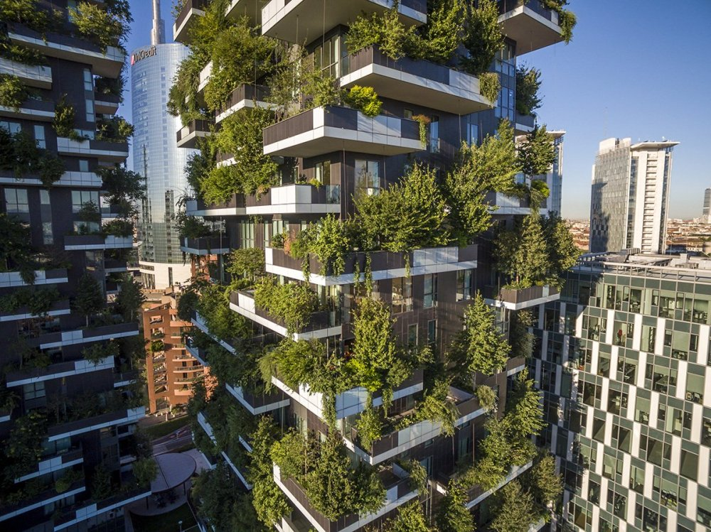 the-balconies-and-rooftops-are-covered-in-approximately-900-trees-each-measuring-between-10-and-30-feet-and-over-20000-plants-ranging-from-shrubs-to-flowers